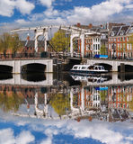 Amsterdam with boats on canal in Holland Royalty Free Stock Photos