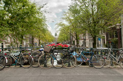Amsterdam bridge, a lot of parked bikes Stock Photos