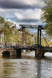 Amsterdam with bridge over canal in Holland Royalty Free Stock Photography