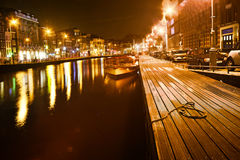 Amsterdam in the bright lights of the night city Royalty Free Stock Photo