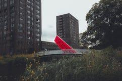 Amsterdam bro med den röda inskriften royaltyfri foto