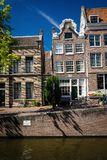 Amsterdam buildings houses architecture canal Holland river royalty free stock images