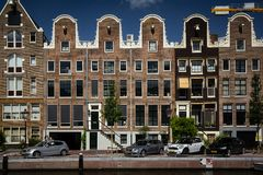 Amsterdam buildings houses architecture canal Holland river stock image