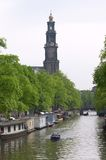 Amsterdam Canal. A view at the Westertower from one of the canals in Amsterdam Royalty Free Stock Photography