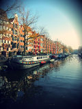 Amsterdam Canal. Beautiful scenic shot of the canal of Amsterdam with boat houses