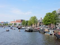 Amsterdam, canal Amstel with Hermitage, Stopera, boats Royalty Free Stock Image