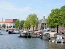 Amsterdam, canal Amstel with Hermitage, Stopera, boats Stock Photos