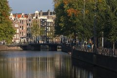 Amsterdam canal in autumn time. Amsterdam canal with colorful trees Stock Image