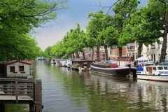 Amsterdam canal. A beautiful canal with boats in Amsterdam Stock Photos