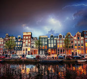Amsterdam canal at beautiful cumulus clouds and lightning Stock Image
