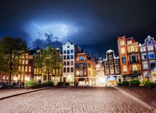 Amsterdam canal at beautiful cumulus clouds and lightning. The city is the capital and most populous city in the. Netherlands Stock Photography