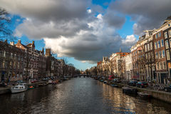 Amsterdam canal. Beautiful sky over homes along an Amsterdam canal Royalty Free Stock Image