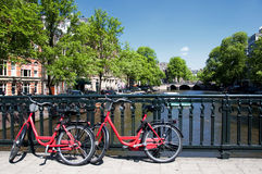 Amsterdam canal and bicycles Royalty Free Stock Photos