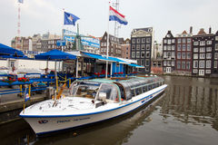 Amsterdam canal boat Stock Images