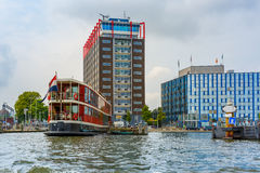 Amsterdam canal, boat and modern building, Holland Stock Image