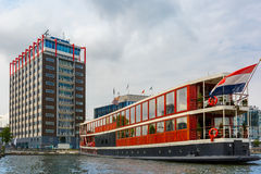 Amsterdam canal, boat and modern building, Holland stock photos