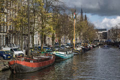 Amsterdam canal with the boats in the autumn in day Stock Image