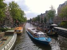 Amsterdam canal. Boats and houseboats on canal in Amsterdam Royalty Free Stock Photos
