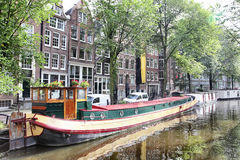 Amsterdam canal with boats. View of Amsterdam canal with boats, Netherlands Royalty Free Stock Photos