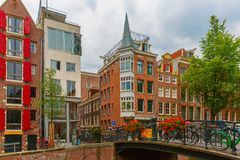 Amsterdam canal and bridge with bikes, Holland Stock Photography