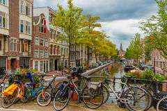 Amsterdam canal and bridge with bikes, Holland Stock Photo