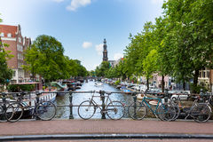 Amsterdam Canal with Bridge and Church Royalty Free Stock Photography