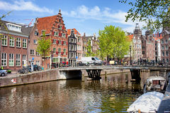 Amsterdam Canal, Bridge and Houses Royalty Free Stock Images
