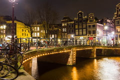 Amsterdam canal and bridge at night Royalty Free Stock Photos
