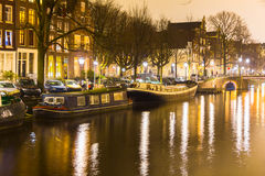 Amsterdam canal and bridge at night Stock Photography