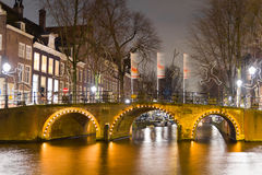 Amsterdam canal and bridge at night Royalty Free Stock Photography