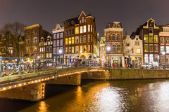 Amsterdam canal and bridge at night Royalty Free Stock Images