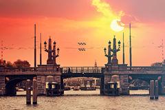 Amsterdam canal bridge at sunset. Royalty Free Stock Image