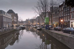 Amsterdam canal and buildings Stock Photography