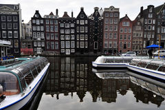 Amsterdam canal. S and typical houses on a cloudy day Royalty Free Stock Image