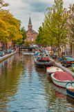 Amsterdam canal, church and typical houses royalty free stock photography