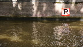 Amsterdam canal close-up. Close-up of a canal in Amsterdam. A no-parking sign is at the right stock video footage