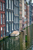 Amsterdam canal Damrak with houses, Netherlands Stock Photo