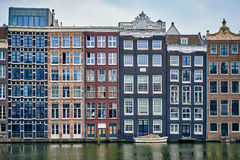 Amsterdam canal Damrak with houses, Netherlands Stock Image
