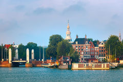 Amsterdam canal with dutch houses Royalty Free Stock Photo