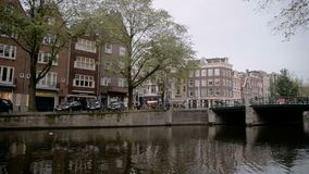Amsterdam, Netherlands. October 15, 2017. Amsterdam canal in fall colors. stock video footage