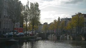 Amsterdam, Netherlands. October 15, 2017. Amsterdam canal in fall colors. stock footage