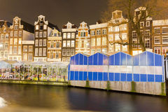 Amsterdam canal and the flower market Royalty Free Stock Photo