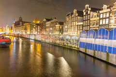 Amsterdam canal and the flower market Stock Images