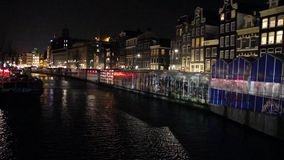 Amsterdam canal and the flower market at night stock footage