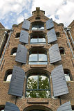 Amsterdam canal house. Restored old warehouse on Amsterdam canal refurbished for loft living Royalty Free Stock Photos