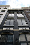 Amsterdam Canal house. Dark canal house in Amsterdam Royalty Free Stock Images