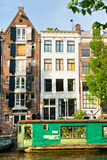 Amsterdam, Canal and houseboat Royalty Free Stock Images