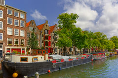 Amsterdam canal with houseboats, Holland Stock Photo