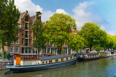 Amsterdam canal with houseboats, Holland Royalty Free Stock Images