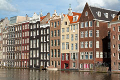 Amsterdam canal houses. Old 17th and 18th century brick houses along a canal on a sunny day in Amsterdam, Holland Stock Photo